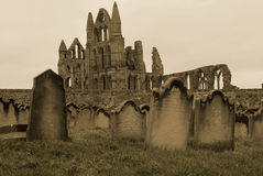 Whitby Gravestones. A sepia coloured picture of a graveyard in Whitby, UK, with the ruined abbey in the background Royalty Free Stock Photos
