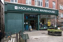 Entrance to Mountain Warehouse outdoor clothing and equipment shop store showing window display, sign, signage, branding and logo