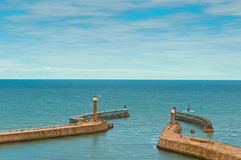 Whitby harbour entrance breakwaters and lighthouses Stock Image