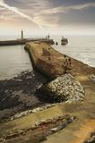 Whitby harbour jetties. Scenic view of jetties at mouth of Whitby harbor, North Yorkshire, England Royalty Free Stock Photography