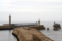 Whitby harbour piers. Royalty Free Stock Photography