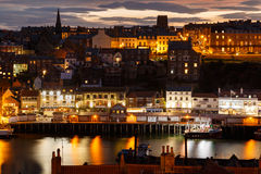 Whitby harbour and town, at night, Stock Photography