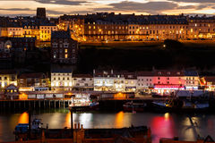 Whitby harbour and town, at night, Stock Images
