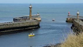 Whitby - North Yorkshire - England. The harbor entrance at the port of Whitby on the North Yorkshire coast in northeast England stock video footage