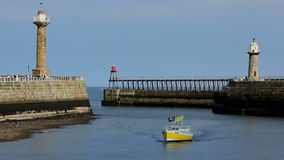Whitby - North Yorkshire - England. The port of Whitby on the North Yorkshire coast in northeast England stock video