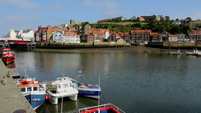Whitby - North Yorkshire - England. The port of Whitby on the North Yorkshire coast in northeast England stock footage