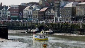 Whitby - North Yorkshire - England. The port of Whitby on the North Yorkshire coast in northeast England. The harbor at low tide stock footage