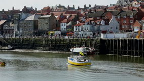 Whitby - North Yorkshire - England. The port of Whitby on the North Yorkshire coast in northeast England. Harbor at low tide stock footage