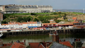 Whitby - North Yorkshire - England. The port of Whitby on the North Yorkshire coast in northeast England. Low tide stock video footage