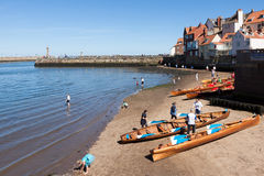 WHITBY, NORTH YORKSHIRE/UK - AUGUST 22 : Rowing boats beached on Royalty Free Stock Image