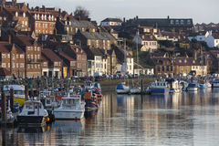 Whitby - North Yorkshire - United Kingdom. The inner harbor in the port of Whitby on the North Yorkshire coast in the United Kingdom. Tourism started in Whitby Royalty Free Stock Photo