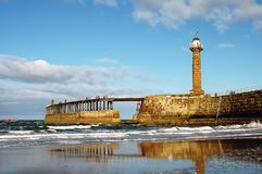 Whitby Pier and light house Stock Images