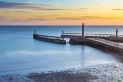 Whitby Pier North Yorkshire, UK. At sunrise. Famous North Yorkshire landmark royalty free stock photo