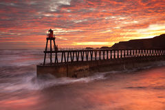 Whitby Pier at sun rise Stock Photography