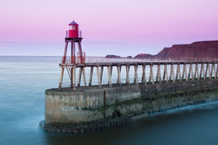 Whitby pier at twilight Stock Photo