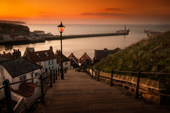 Whitby Steps at Sunset. Sunsets over the famous harbour of Whitby, Landing place of Dracula Stock Photos