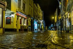 Whitby street in the rain at night. royalty free stock photo