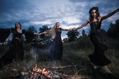 Whitches coven. Dark night. Fire Royalty Free Stock Image