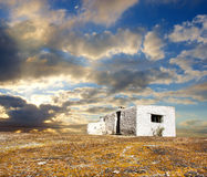 White abandoned house under dramatic sunset skies Royalty Free Stock Images