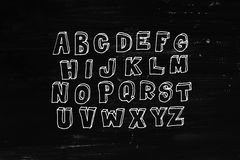 White abc over black chalkboard Stock Photo