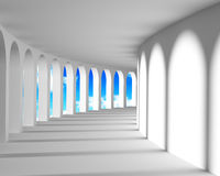 White abstract corridor with columns. And blue sky outside Stock Images