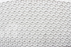 White abstract facade. White abstract pattern facade side view of modern building in business district at noon background - texture Royalty Free Stock Photos