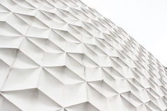 White abstract facade. White abstract pattern facade side view of modern building in business district at noon background - texture Royalty Free Stock Images