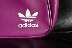 White Adidas logo on fashion leather bag Royalty Free Stock Photos