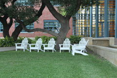 White Adirondack Wood Lawn Chairs Royalty Free Stock Image