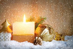 White advent candle and snow. Stock Photos