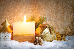 White advent candle and snow. Stock Images