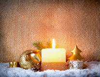 White advent candle and snow. Royalty Free Stock Photos