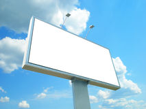 White advertisement hoarding. Against the blue sky Royalty Free Stock Images