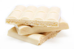 White aerated chocolate. Slices of  white aerated chocolate isolated on white background Stock Photography