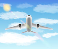 White aero plane flying in a sky Stock Image