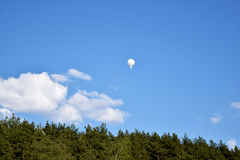 White air balloon in the blue sky Stock Photo