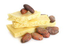 White air chocolate with Cocoa beans before roast. Royalty Free Stock Images