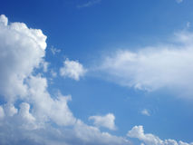 White air clouds in the bright blue sky. White air clouds float on the bright blue sky Royalty Free Stock Photography