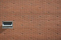 White Air Ventilation Window on Brown Concrete Brick Wall Stock Image