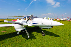 White airplane on a green grass field Stock Photography