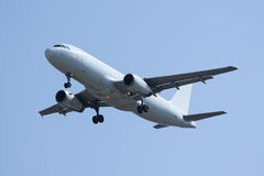 White Airplane landing. With Blue sky, Airbus A320 Royalty Free Stock Photography