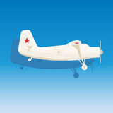 White military airplane with the stars on blue background.  Stock Photo