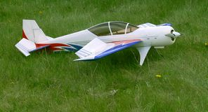 White airplane model. On a grass field Stock Photo