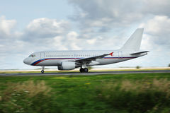 White airplane moves along Runway Royalty Free Stock Photo