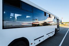Big bus in the airport. White airport bus close up royalty free stock image