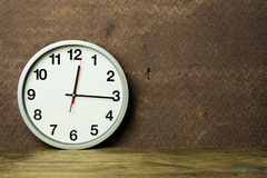 White alarm clock on wooden table Royalty Free Stock Photo