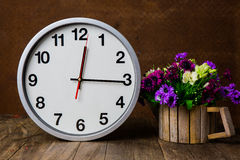 White alarm clock on wooden table Royalty Free Stock Images