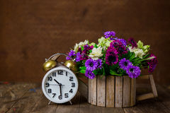 White alarm clock on wooden table Royalty Free Stock Image