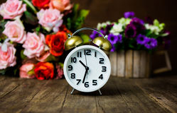 White alarm clock on wooden table Stock Image