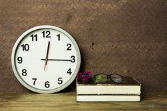 White alarm clock on wooden table Stock Photography